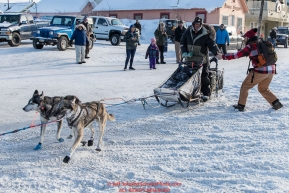 Ray Redington Jr. gets a high-five as he runs on Front Street in Nome on the way to the a 4th place finish on Wednesday March 14th in the 46th running of the 2018 Iditarod Sled Dog Race.  Photo by Jeff Schultz/SchultzPhoto.com  (C) 2018  ALL RIGHTS RESERVED