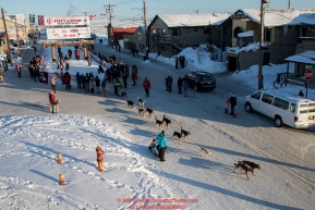 Aaron Burmeister's teams leaves the finish chute in Nome after he completed the 46th running of the Iditarod on Wednesday March 14th during the 2018 Iditarod Sled Dog Race.  Photo by Jeff Schultz/SchultzPhoto.com  (C) 2018  ALL RIGHTS RESERVED