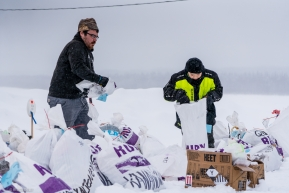 Nate and Levi of Ruby, Alaska are helping to locate musher bags and get them to the staging area on March 14, 2020.