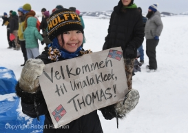 Aliana Towarak welcomes Iditarod musher Thomas Waerner at the Unalakleet, AK Iditarod checkpoint after the musher arrived in first place on Sunday, March 15, 2020. Towarak's mother's family is from Norway. (Photo by Bob Hallinen)