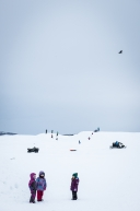 Local children of Unalakleet filled the checkpoint with fun and laughter sledding on the hills nearby, March 15th, 2020.