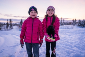 Local kids from Koyuk came out to see the sled dogs and showed off their new puppy on March 16, 2020.
