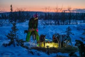 Ryan Reddington gets his dogs ready to leave Koyuk on March 16, 2020.
