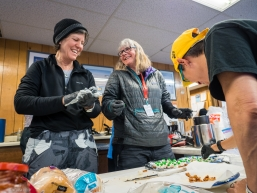 Veterinarians and race judges create St Patrick's Day hors d'ouvres at the Koyuk checkpoing on March 17, 2020.