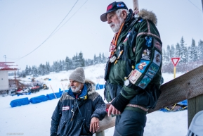 Veterinarians Bill Sampson and George Stroberg during an unusual break in the action at Koyuk on March 17, 2020.
