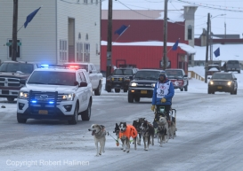 Joar Leifseth Ulsom drives his team down Front Street in Nome, AK to finish the 2020 Iditarod Trail Sled Dog Race in 6th place on Front Street on Wednesday, March 18, 2020. (Photo by Bob Hallinen)