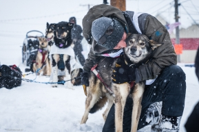 Jeff Deeter gives a big hug to one of his dog team after crossing the finish line of the Iditarod on March 18, 2020.