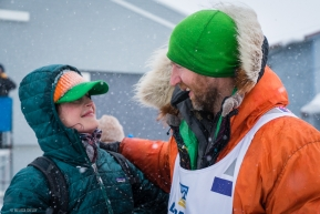 Kelly Maixner greats his wife with a smile after completing the Iditarod on March 18, 2020.