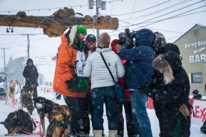 Kelly Maixner is surrounded by media after completing the Iditarod in Nome, AK on March 18, 2020.
