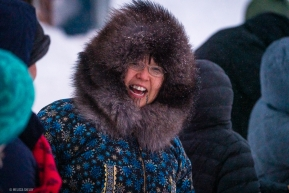 A fan in Nome, AK braves the weather to cheer in Aily Zirkle on March 18, 2020.