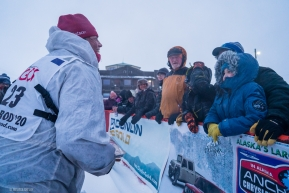 Aily Zirkle greats fans at the Iditarod finish line in Nome, AK on March 18, 2020.