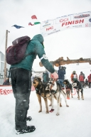 Kelly Maixner of Big Lake, AK, finishes in Nome in 17th place in the 2020 Iditarod on March 18th, 2020.