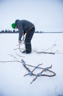 Kelly Maixner, making snowshoes to carry with him to Nome, his real pair was delivered moments after. White Mountain, March 18th, 2020.