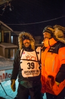 Rookie Tom Frode Johansen, of Furuflaten, Norway Finished in Nome in 19th place in the 2020 Iditarod, March 19th, 2020. Photographed with Thomas Waerner, of  Torpa, Norway, who was the first to Nome.
