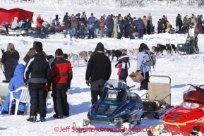 Sunday, March 4, 2012  Ray Redington, Jr. on Long Lake with a crowd of spectators at the restart of Iditarod 2012 in Willow, Alaska.