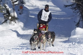 Sunday, March 4, 2012  Lance Mackey drops onto Long Lake at the restart of Iditarod 2012 in Willow, Alaska.