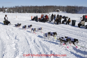 Sunday, March 4, 2012  Nicolas Petit passes a group of spectators on Long Lake at the restart of Iditarod 2012 in Willow, Alaska.