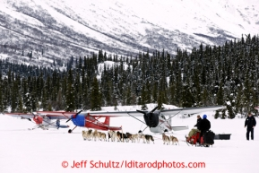 Paul Gebhardt runs past airplanes on his way out of the Rainy Pass checkpoint March 4, 2013.