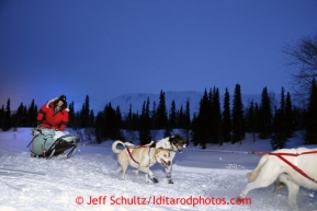 Ray Reddington, Jr., of Wasilla arrives at the Finger Lake checkpoint Monday, March 4, 2013.