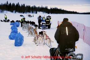 Jim Lanier of Chugiak waits in line as other teams check in at the Finger Lake checkpoint Monday, March 4, 2013.