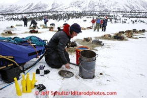 Michelle Phillips gets food ready for her dogs at Rainy Pass checkpoint March 4, 2013.
