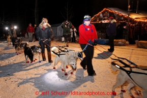 Volunteers park Mitch Seavey in the evening at the Rohn checkpoint during the 2013 Iditarod sled Dog Race   March 4, 2013.  Photo by Jeff Schultz Do Not Reproduce without permission
