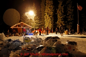 Volunteers hold a team at the Rohn checkpoint in the morning during the 2013 Iditarod sled Dog Race   March 5, 2013.  Photo by Jeff Schultz Do Not Reproduce without permission